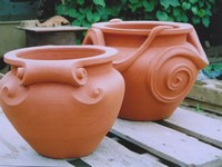 Scroll pot and snake pot