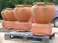 Large scroll pots on pedestals